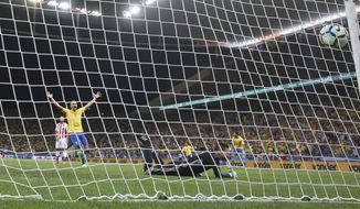 Brazil's Renato Augusto celebrates his side's first goal against Paraguay during a 2018 World Cup qualifying soccer match at the Arena Corinthians Stadium in Sao Paulo, Brazil, Tuesday, March 28, 2017. (AP Photo/Andre Penner)