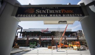 Restaurant and retails stores sit across from SunTrust Park, the Atlanta Braves' new baseball stadium in Atlanta, Wednesday, March 29, 2017. The Braves' new ballpark looks like a throwback stadium with its green seats, brick walls and its old-school, intimate feel. That's from an initial glance inside the park. Beyond the stadium walls sits the real wow factor that could be a game-changer for the industry. (AP Photo/David Goldman)