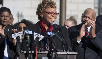 Camden Mayor Dana Redd announces she will not seek re-election after two terms, Wednesday, March 29, 2017, in Camden, N.J. Redd is given an ovation near the end of her speech in front of Camden City Hall. The Camden native served on the City Council and was a state senator before she was first elected mayor in 2009. (Charles Fox /The Philadelphia Inquirer via AP)