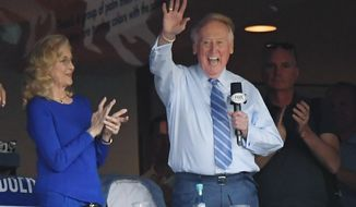 FILE - In this Oct. 20, 2016, file photo, Vin Scully acknowledges the crowd from a box before Game 5 of the National League baseball championship series between the Chicago Cubs and the Los Angeles Dodgers in Los Angeles. On Monday, April 3, 2017, the Dodgers will play their first opening day since 1950 without Scully calling their games. He won't be in the stands. He won't make a point of watching on TV, either. (AP Photo/Mark J. Terrill, File)