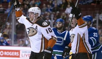 Anaheim Ducks right wing Corey Perry (10) celebrates his goal with teammate Nick Ritchie (37) during first period NHL hockey action against the Vancouver Canucks, in Vancouver, British Columbia, Tuesday, March 28, 2017. (Jonathan Hayward/The Canadian Press via AP)