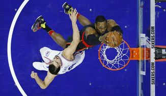 Atlanta Hawks' Dwight Howard, right, dunks the ball against Philadelphia 76ers' Dario Saric during the first half of an NBA basketball game, Wednesday, March 29, 2017, in Philadelphia. (AP Photo/Matt Slocum)