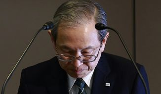 Toshiba Corp. President Satoshi Tsunakawa bows during a press conference at the company's headquarters in Tokyo, Wednesday, March 29, 2017. Japan's embattled Toshiba said Wednesday that its U.S. nuclear unit Westinghouse Electric Co. has filed for bankruptcy protection. Toshiba said in a statement that it filed the chapter 11 petition in the U.S. Bankruptcy Court of New York. (AP Photo/Shizuo Kambayashi)