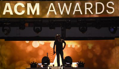 FILE - In this April 19, 2015 file photo, Jason Aldean performs at the 50th annual Academy of Country Music Awards at AT&T Stadium in Arlington, Texas.   The ACM Awards, airing Sunday, April 2, 2017 on CBS  are relying on two likable co-hosts, tried and true stars of the format, cross-genre collaborations, a party vibe and new music to keep fans tuned in.(Photo by Chris Pizzello/Invision/AP)