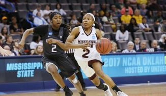 In this Friday, March 24, 2017 photo, Mississippi State guard Morgan William (2) drives past Washington guard Aarion McDonald (2) during the second half of a regional semifinal of the NCAA women's college basketball tournament in Oklahoma City. Women's basketball saw its lowest attendance for the regionals in 20 years and there is no change to the format in sight. (AP Photo/Sue Ogrocki)
