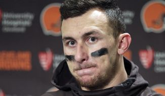 "FILE - In this Dec. 20, 2015, file photo, Cleveland Browns quarterback Johnny Manziel speaks with media members following the team's 30-13 loss to the Seattle Seahawks in an NFL football game in Seattle. New Orleans Saints coach Sean Payton shot down a report that his team had interest in troubled quarterback Johnny Manziel. They did meet during Super Bowl week, but Payton called the report the team was considering adding Manziel ""false."" (AP Photo/Scott Eklund, File)"