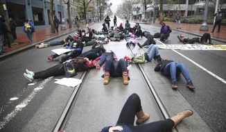 People protest the fatal police shooting of Quanice Hayes, a 17-year-old black teenager, on Wednesday, March 29, 2017, in Portland, Ore. A Multnomah County grand jury concluded last week that Officer Andrew Hearst was justified in shooting Hayes three times after police say Hayes reached for his waistband instead of following orders to surrender. (Stephanie Yao Long/The Oregonian via AP) ** FILE **