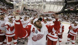 FILE - In this June 4, 2008, file photo, Detroit Red Wings' Henrik Zetterberg, of Sweden, holds the Stanley Cup after the Red Wings defeated the Pittsburgh Penguins in Game 6 of the Stanley Cup hockey finals in Pittsburgh. For the first time since 1990, the Red Wings won't be in the NHL playoffs in 2017. A remarkable run, tied for the third longest in league history, has ended as it was expected to this season with a banged-up roster that is void of stars. (AP Photo/Gene J. Puskar)