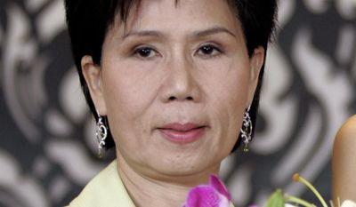 FILE - In this June 1, 2005, file photo, Juthamas Siriwan, the former governor of the Tourism Authority of Thailand, in Bangkok, Thailand.  Juthamas Siriwan has been sentenced to 50 years in prison for accepting $1.8 million in bribes from two Hollywood producers to let them organize the Bangkok International Film Festival a decade ago. (AP Photo/Apichart Weerawong, File)