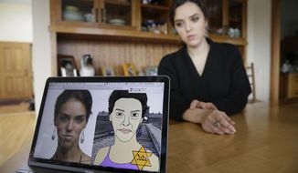 In this Feb. 21, 2017, photo, Erin Schrode poses behind a laptop displaying anti-Semitic images of herself that she received in her email and social media at her home in Mill Valley, Calif. Less than a week before the election for her long-shot congressional campaign, Schrode woke up in her northern California home, rolled over in bed and reflexively checked her cellphone. The 25-year-old activist burst into tears when she found a barrage of anti-Semitic emails. (AP Photo/Eric Risberg)
