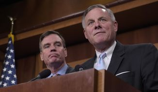 Senate Intelligence Committee Chairman Sen. Richard Burr, R-N.C., right, and the committee's Vice Chairman Sen. Mark Warner, D-Va. meet with reporters on Capitol Hill in Washington, Wednesday, March 29, 2017, to discuss the committee's investigation of Russian interference in the 2016 election. (AP Photo/Susan Walsh)