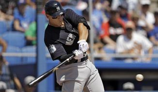 New York Yankees' Aaron Judge lines an RBI single off Toronto Blue Jays starting pitcher J.A. Happ during the second inning of a spring training baseball game Wednesday, March 29, 2017, in Dunedin, Fla. Yankees' Starlin Castro scored. (AP Photo/Chris O'Meara)