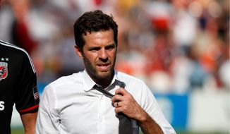 """D.C. United coach Ben Olsen said """"there's certainly no panic button around here"""" despite his team's 0-2-1 start. (Associated Press)"""