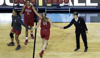Stanford head coach Tara Vanderveer, right, works with her players during practice at the women's NCAA Final Four college basketball tournament, Thursday, March 30, 2017, in Dallas. (AP Photo/Eric Gay)