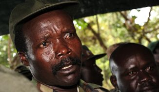 FILE - In this Nov. 12, 2006 file photo, the leader of the Lord's Resistance Army, Joseph Kony answers journalists' questions following a meeting with UN humanitarian chief Jan Egeland at Ri-Kwangba in southern Sudan. A rebel in charge of communications for warlord Joseph Kony has surrendered to Ugandan forces, the military said Thursday, March 30, 2017 shortly after the U.S. indicated it was pulling out of the international manhunt for one of Africa's most notorious fugitives. (Stuart Price, Pool Photo via AP, File)