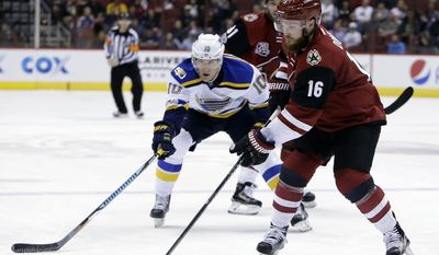 Arizona Coyotes left wing Max Domi (16) skates with the puck in front of St. Louis Blues right wing Scottie Upshall in the second period during an NHL hockey game, Wednesday, March 29, 2017, in Glendale, Ariz. (AP Photo/Rick Scuteri)
