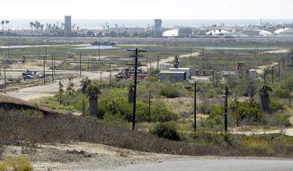 FILE - This Aug. 18, 2016, file photo shows Banning Ranch, including what remains of an oil-extraction operation, on what is believed to be the biggest piece of privately-owned vacant land on Southern California's coast in Newport Beach, Calif. California's Supreme Court ruled on Thursday, March 30, 2017, that an upscale coastal city failed to adequately consider the environmental impacts of a plan to build homes on a large swath of land overlooking the Pacific Ocean. The court found that the city of Newport Beach should have considered environmentally sensitive habitat areas when drafting a review of a hotly-contested proposal to develop the 401-acre parcel known as Banning Ranch. (AP Photo/Nick Ut, File)