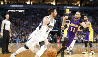 CORRECTS TO KINGS' TYLER ENNIS NOT ANZE KOPITAR - Minnesota Timberwolves' Ricky Rubio, left, of Spain, drives around Los Angeles Kings' Tyler Ennis during the first half of an NBA basketball game Thursday, March 30, 2017, in Minneapolis. (AP Photo/Jim Mone)