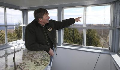 ADVANCE FOR USE SATURDAY, APRIL 1, 2017, AT 3:01 A.M. EDT AND THEREAFTER - In this March 9, 2017, photo, Jack Zborovian, forest fire specialist supervisor for Pennsylvania Department of Conservation and Natural Resources (DCNR), gestures while inside a fire lookout tower in Mehoopany Twp., Pa. (Christopher Dolan/The Citizens' Voice via AP)