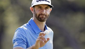 FILE - In this March 26, 2017, file photo, Dustin Johnson waves to the gallery after a birdie putt on the sixth hole during semifinal play at the Dell Technologies Match Play golf tournament at Austin County Club in Austin, Texas. (AP Photo/Eric Gay, File)
