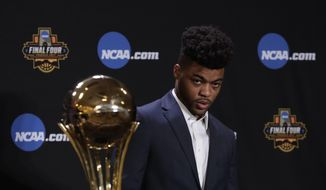 Kansas' Frank Mason III stands near his Associated Press Player of the Year trophy at a news conference Thursday, March 30, 2017, in Glendale, Ariz. (AP Photo/Matt York) **FILE**