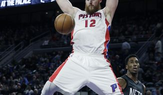 Detroit Pistons center Aron Baynes dunks during the first half of an NBA basketball game against the Brooklyn Nets, Thursday, March 30, 2017, in Auburn Hills, Mich. (AP Photo/Carlos Osorio)