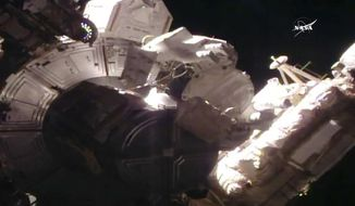 This still image taken from NASA shows NASA astronaut Peggy Whitson during a space walk at the  International Space Station on Thursday, March 30, 2017. Whitson, the world's oldest and most experienced spacewoman has just set another record, her eighth spacewalk. Whitson and her spacewalking partner, Shane Kimbrough need to complete prep work on a docking port.  (NASA via AP)