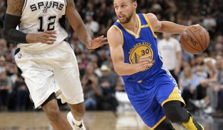 Golden State Warriors guard Stephen Curry (30) drives around San Antonio Spurs forward LaMarcus Aldridge during the first half of an NBA basketball game, Wednesday, March 29, 2017, in San Antonio. (AP Photo/Darren Abate)
