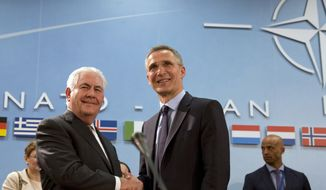 U.S. Secretary of State Rex Tillerson, left, shakes hands with NATO Secretary General Jens Stoltenberg during a meeting of the North Atlantic Council at NATO headquarters in Brussels on Friday, March 31, 2017. U.S. Secretary of State Rex Tillerson meets with his NATO counterparts in Brussels for the first time looking to persuade reluctant allies to increase defense spending and do more to combat terrorism. (AP Photo/Virginia Mayo)