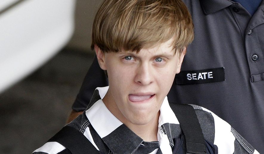 In this June 18, 2015, file photo, Charleston, S.C., shooting suspect Dylann Storm Roof is escorted from the Cleveland County Courthouse in Shelby, N.C. (AP Photo/Chuck Burton, File)