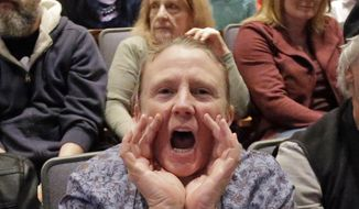 A woman shouts during Republican U.S. Rep. Chris Stewart town hall meeting Friday, March 31, 2017, in Salt Lake City. Stewart says he knows that many of those attending his town hall in heavily Democratic Salt Lake City probably didn't vote for him, but the Republican congressman says he feels it's important to appear before his constituents. (AP Photo/Rick Bowmer)