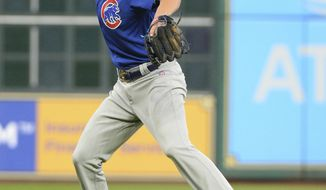 Chicago Cubs third baseman Kris Bryant throws out Houston Astros' George Springer during the first inning of an exhibition baseball game Friday, March 31, 2017, in Houston. (AP Photo/George Bridges)