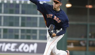 Houston Astros starter Joe Musgrove pitches against the Chicago Cubs during the first inning of an exhibition baseball game Friday, March 31, 2017, in Houston. (AP Photo/George Bridges)
