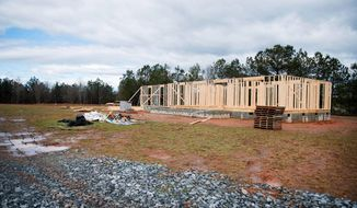 ADVANCE FOR MONDAY, APRIL 3, 2017 - This Tuesday, March 14, 2017 photo, shows one of seven homes being built at LIFEhouse Church that will house foster families in Easley, S.C. (Lauren Petracca /The Greenville News via AP)