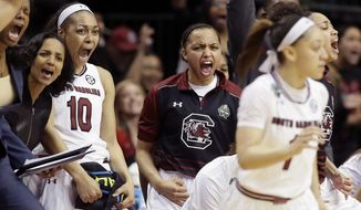 South Carolina guard Allisha Gray (10) and teammates celebrate during the second half of an NCAA college basketball game against Stanford in the semifinals of the women's Final Four, Friday, March 31, 2017, in Dallas.(AP Photo/Tony Gutierrez)