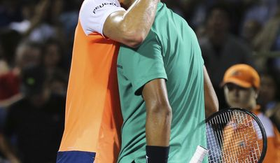 Alexander Zverev, of Germany, congratulates Nick Kyrgios, of Australia, on Kyrgios' 6-4, 6-7 (9), 6-3 win during a quarterfinal at the Miami Open tennis tournament, Thursday, March 30, 2017, in Key Biscayne, Fla. (AP Photo/Mario Houben)