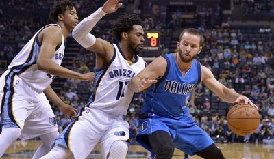 Dallas Mavericks guard J.J. Barea (5) controls the ball against Memphis Grizzlies guard Mike Conley, center, forward Deyonta Davis, left, in the first half of an NBA basketball game Friday, March 31, 2017, in Memphis, Tenn. (AP Photo/Brandon Dill)