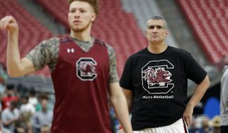 South Carolina head coach Frank Martin watches as Hassani Gravett warms up during a practice session for their NCAA Final Four tournament college basketball semifinal game Friday, March 31, 2017, in Glendale, Ariz. (AP Photo/David J. Phillip)