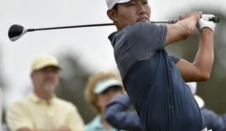 Sung Kang watches his tee shot on the third hole during the third round of the Houston Open golf tournament, Saturday, April 1, 2017, in Humble, Texas. (AP Photo/Eric Christian Smith)