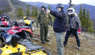 """This 2005 photo provided by the Alaska Department of Natural Resources shows then-Rep. Mike Kelly, pointing, during a six-hour four-wheeler ride on a trail north of Two Rivers, Alaska, that had been made nearly impassible by state reclamation efforts. He called the trip """"miserable and ugly."""" Through his efforts, state officials agreed to rework the trail and preserve it. Kelly died at 74 in December, 2016 when a plane he was piloting crashed. In March, 2017, Gov. Bill Walker announced he has renamed the 13.5-mile trail as the """"Mike Kelly Trail"""" on maps and signage. (Tim Mowry/Alaska Department of Natural Resources via AP)"""