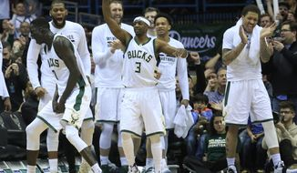 The Milwaukee Bucks react after a defensive play against the Detroit Pistons during overtime of an NBA basketball game Friday, March 31, 2017, in Milwaukee. (AP Photo/Darren Hauck)