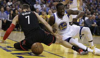 Houston Rockets' Sam Dekker (7) and Golden State Warriors' Draymond Green, right, fight for the ball during the first half of an NBA basketball game Friday, March 31, 2017, in Oakland, Calif. (AP Photo/Ben Margot)