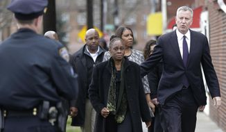 New York City Mayor Bill de Blasio, right, his wife, Chirlane McCray , left, and Public Advocate Letitia James, arrive for the funeral services for Timothy Caughman Saturday, April 1, 2017, in New York.  Caughman was alone and collecting bottles for recycling last month when he was attacked from behind with a sword.  Authorities say his assailant, James Harris Jackson, took a bus last month to New York to target black men.  Jackson is being held without bail on charges of murder as a hate crime.   (AP Photo/Frank Franklin II)
