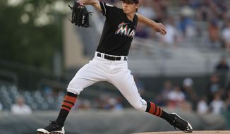 Miami Marlins starting pitcher Adam Conley (61) works in the first inning of a spring training baseball game against the Detroit Tigers, Friday, March 31, 2017, in Jupiter, Fla. (AP Photo/John Bazemore)