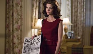 """This undated image provided by ReelzChannel, shows Katie Holmes as Jackie Kennedy Onassis in the REELZ original miniseries, """"The Kennedys-After Camelot."""" The two hour premiere airs Sunday, April 2, 2017 at 9 p.m.ET/8 p.m. PT. Ken Woroner/(ReelzCannel via AP)"""
