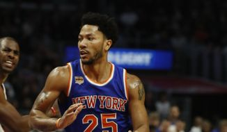 FILE - In this March 20, 2017, file photo, New York Knicks guard Derrick Rose dribbles during the second half of an NBA basketball game against the Los Angeles Clippers in Los Angeles. Rose needs surgery to repair torn left knee cartilage and the Knicks say he will miss the rest of the season. (AP Photo/Ryan Kang, File)