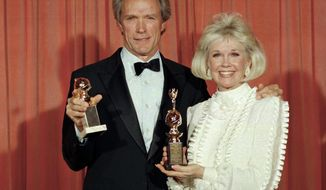 """FILE - In this Jan. 29, 1989 file photo, Clint Eastwood poses with Doris Day at the 46th annual Golden Globe Awards in Beverly Hills, Calif. Eastwood won a Golden Globe for motion picture directing for his work on """"Bird,"""" and Day was honored with the Cecil B. DeMille Award for her outstanding contribution to the film industry. The film and recording star Day is marking her birthday Monday, April 3, 2017, with a social media campaign to highlight her love of animals. (AP Photo/Douglas C. Pizac, File)"""