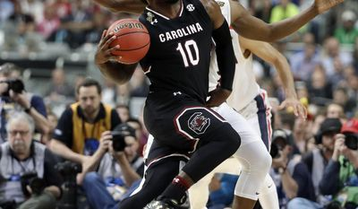 South Carolina's Duane Notice (10) drives against Gonzaga's Jordan Mathews during the second half in the semifinals of the Final Four NCAA college basketball tournament, Saturday, April 1, 2017, in Glendale, Ariz. (AP Photo/Mark Humphrey)