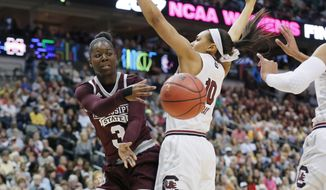 Mississippi State forward Breanna Richardson (3) passes the ball around South Carolina guard Allisha Gray (10) during the first half of the final of NCAA women's Final Four college basketball tournament, Sunday, April 2, 2017, in Dallas. (AP Photo/Tony Gutierrez)