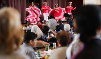"Dancers perform at a Women's Day celebration sponsored by Welcome Dayton, Saturday, March 4, 2017, in Dayton, Ohio. President Donald Trump's tough talk and new policies on immigration have cast a cloud over Dayton that's linked its future to attracting and keeping foreign-born residents. The ""Welcome Dayton"" initiative has helped halt population decline, add well-educated, skilled workers, and revitalize rundown neighborhoods in a Rust Belt city that was reeling from the recession and losing a signature company. (AP Photo/John Minchillo)"